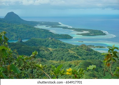 Huahine island landscape from the mountain Pohue Rahi, forest with the lagoon and islets, south Pacific ocean, Leeward islands, French Polynesia