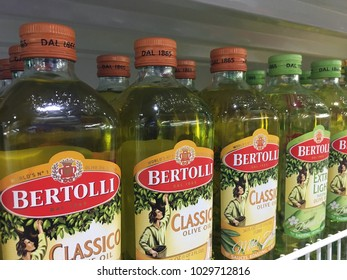 HuaHin,Thailand-Feb 12 2018 : Shopping mall  selling olive oil from Bertolli brand with two kind that is extra light and classico on the shelf.