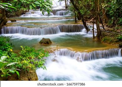 Huai Mae Khamin waterfall idyllic in rainy season and natural in Kanchanaburi province Thailand.Huai Mae Khamin waterfall is in rain forest and tree green