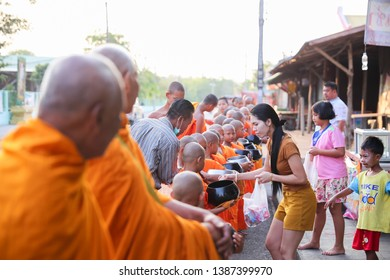 Huai Rat/Buriram - April 03, 2019: The congregation offered alms to the new novices, on The 5th Summer Novice Ordination Ceremony in Huai Rat, Thailand.