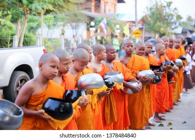 Huai Rat/Buriram - April 3, 2019: Summer Novice Ordination Ceremony in Huai Rat, Buriram Thailand. The congregation offered alms to the new novices.
