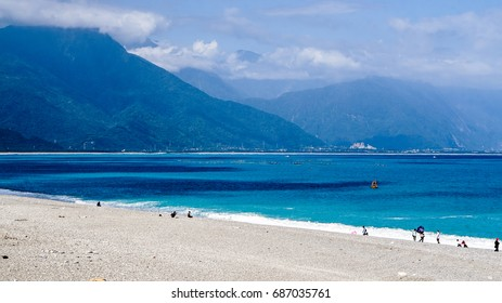 Hualien ocean of Taiwan. China. Beautiful blue sea with lush mountain and granite pebble beach