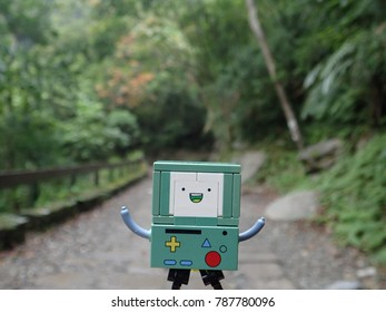Hualien, Taiwan - 29 Dec 2017: Lego BMO, a character from Adventure Time, traveling in Taroko national park.
