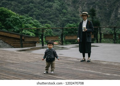 Hualien, Taiwan - April 7, 2018: Little boy play with his mom at Taroko National Park, Hualien, Taiwan.