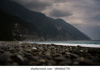 HUALIEN, TAIWAN - FEBRUARY 1, 2020: Qingshui Cliffs, Taiwan as seen from the surrounding coastline with dark clouds above and a choppy sea.