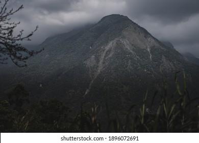 HUALIEN, TAIWAN - JANUARY 31, 2020: Dark clouds form above the peak of a mountain in Taroko National Park, Taiwan.