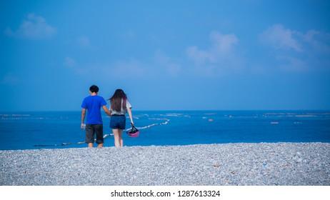 Hualien, Taiwan - May 25 2015: Lovers walking at Qixingtan (Chihsingtan) Beach in Taiwan