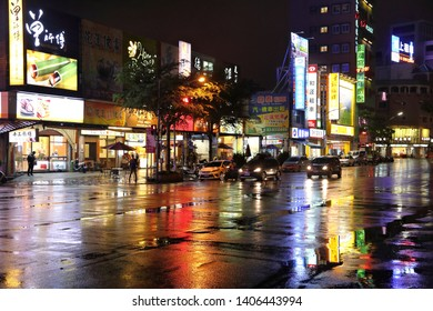 HUALIEN, TAIWAN - NOVEMBER 24, 2018: Rainy night reflection of Hualien, Taiwan. Hualien is one of the biggest cities on Taiwan's east coast.