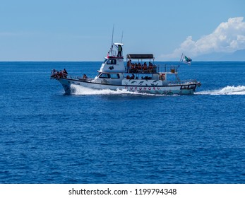 Hualien, Taiwan - September 22, 2018: A whale watching boat with tourists.