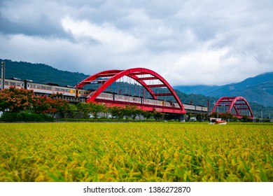 "Hualien village and train scenery in eastern Taiwan, the Chinese characters on the bridge are: ""Hualien No. 1 Bridge and No. 2 Bridge"""