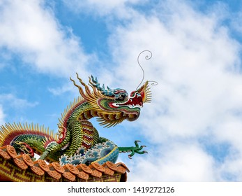 HUALIEN/TAIWAN -MAY 11 2019: Detail of dragon on the roof of Kang Ten Temple in Hualien Taiwan with copy space.