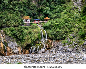 HUALIEN/TAIWAN-MAY 11 2019: Pretty waterfall and shrine at the Eternal Spring Shrine or Changchun Temple in Hualien Taiwan