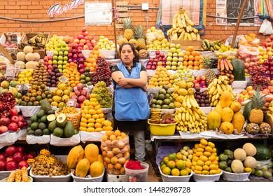 Huancayo, Junin / Peru - April 18th 2019: Woman selling fruits in an street market
