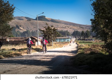HUANCAYO, PERU - CIRCA 2017: Two boys in bike goes with school uniform and backpacks circa 2017, in Huancayo, Peru.