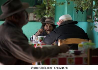 HUANCAYO, PERU - CIRCA 2017: An unidentified old woman eat in a restaurant circa 2017, in Huancayo, Peru.
