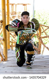 HUANCAYO, PERU - JUNE 20, 2019: Caporales dancers in the decorated costumes. Photo session Cast of Dance Caporales Sambos Illimani Filial Huancayo