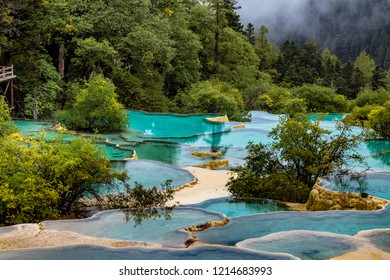 Huanglong National Park, Sichuan, China, famous for its colorful pools formed by calcite deposits. Situated at more than 3000m elevation, it is a UNESCO World heritage site