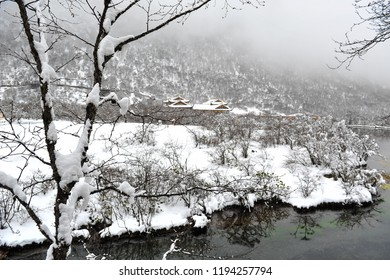 Huanglong National Park while snow is falling in winter.