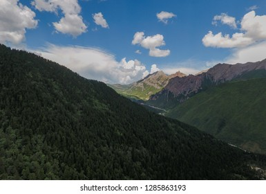 Huanglong Valley mountain landscape in Sichuan China, aerial drone photo