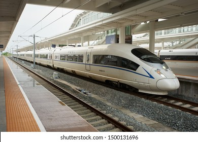 Huangshan, Anhui Province, China - Aug 12, 2019: An 8-car CRH380B electric high-speed train is seen in the Huangshan North Railway Station. It is designed to operate at a cruise speed of 350 km/h.