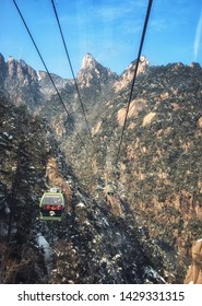 Huangshan, China - December 23, 2013: People traveling up to the top of Yellow Mountain by cable car on an Autumn day, Huangshan, Anhui province, China, Asia