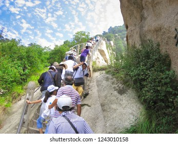 Huangshan, China - July 11, 2010: Tourists visit the famous Huangshan mountain. Mountain Huangshan is World cultural and natural heritage. It is one of the chief tourist attractions in China.
