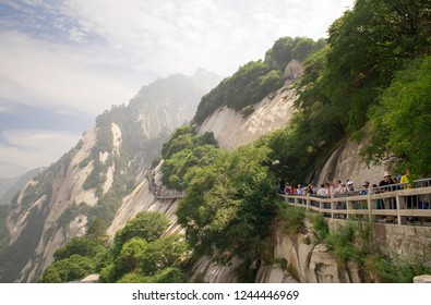Huangshan, China - July 25, 2010: Tourists visit the famous Huangshan mountain. Mountain Huangshan is World cultural and natural heritage. It is one of the chief tourist attractions in China.