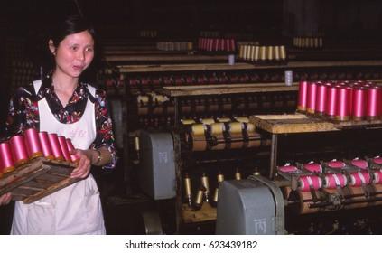 HUANGSHAN, CHINA - MAY 26, 2005  - Young women working in a silk factory co-operative,  Huangshan, China