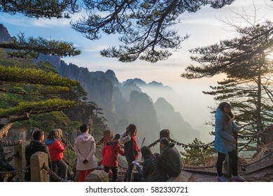 HUANGSHAN - FEB 7: Tourists visit the famous Huangshan mountain on 7 February 2017 in Huangshan, China. Huangshan is China's most famous mountain and receives more than 2.7 million people per year.