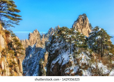Huangshan is a mountain range in southern Anhui province in eastern China. The area is well known for its scenery, sunsets, peculiarly-shaped granite peaks, Huangshan pine trees and hot springs.