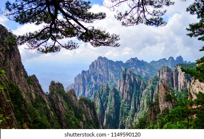 Huangshan (Yellow Mountain) Cliffs and Huangshan Pine. Located at Anhui province China, Huangshan is a UNESCO World heritage site and one of China's major tourist destinations.