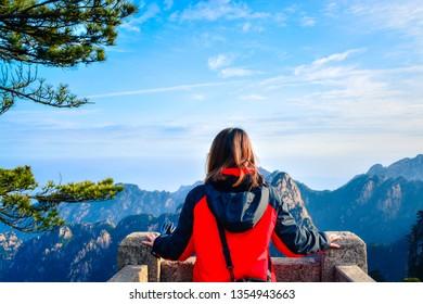 HUANGSHAN,CHINA 16 january 2016 - the girl watching the view of Huangshan mountain