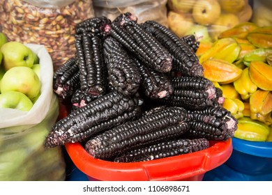 Huaraz, Peru - October 01, 2015: Black corn cobs at the local market