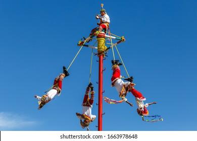 "HUASCA DE OCAMPO / MEXICO - DECEMBER 2015: People performing Palo Volador, ""Dance of the Flyers"", traditional ceremony, Huasca de Ocampo, Hidalgo, Mexico"