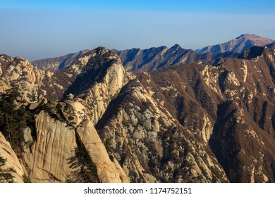 Huashan Scenery, Mount Hua - Huayin, near Xi'an in Shaanxi Province China. Chess Playing Pavilion, Pagoda at the top of a Cliff with Steep Vertical Drop-off, Famous yellow granite mountains of China.