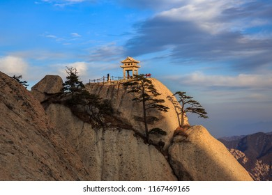 Huashan Sunset, Mount Hua - Huayin, near Xi'an in Shaanxi Province China. Chess Playing Pavilion, Pagoda at the top of a Cliff with Steep Vertical Drop-off, Famous yellow granite mountains of China.