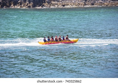 Huatulco, Mexico, 2016:03:06, Riding on an inflatable banana on the water.  Riding tourists on water inflatable banana is a classic for any seaside resort.