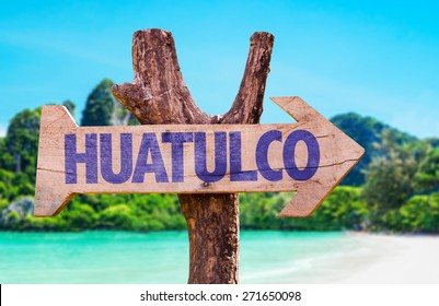 Huatulco wooden sign with beach background