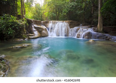 Huay Mae Kamin Waterfall, beautiful waterfall in  forest, Kanchanaburi , Thailand. Jungle landscape with flowing turquoise water at deep tropical rain forest. National Park Kanchanaburi, Thailand