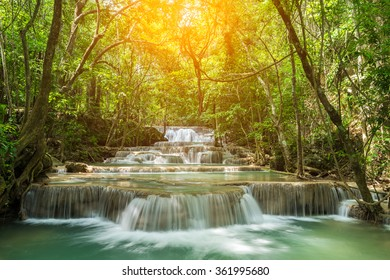 Huay Mae Kamin waterfall in Kanchanaburi at Thailand on sunlight.