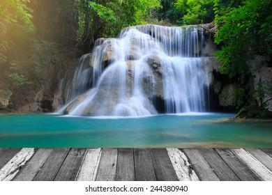 Huay Mae Kamin Waterfall and wood pier, beautiful waterfall in autumn forest, Kanchanaburi province, Thailand