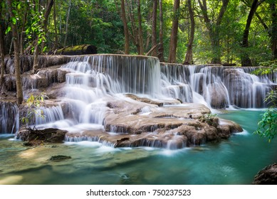 Huay Mae Khamin waterfall with sun light in tropical forest of national park, Thailand
