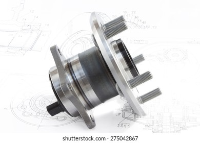 hub with bearing and ABS sensor on the background of drawings and plans