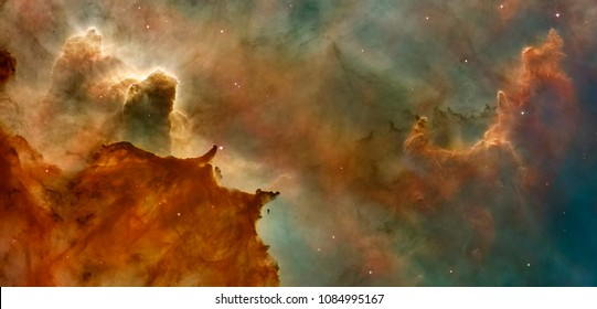 Hubble image of the  Eagle Nebulaas Pillars of the Creation. Elements of this image furnished by NASA.