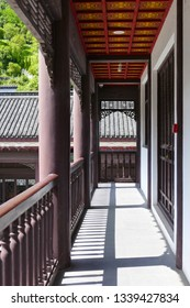 Hubei, China, June 6 2016: corridor in Qu Yuan memorial temple on the hillside east of the Zigui County near 3 gorges reservoir, Yangtze river. It has white gateway and walls edged in red.