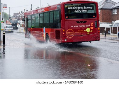 Hucknall, Nottinghamshire, UK. August 15th 2019. Public passenger bus passes through floods water after day of unseasonable summer weather.