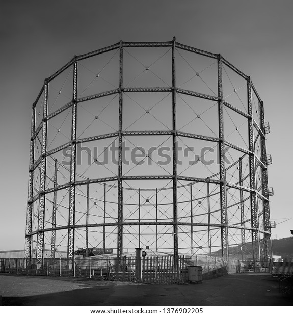 Huddersfield, England - Mar 2019: Empty Gasometer - Black and white image showing the steel framed upper structure of a gasometer used for storage of natural gas fuel.