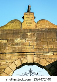 HUDDERSFIELD, UK - APRIL 10, 2019: View of the Western entrance to the Huddersfield Cloth Hall relocated to Ravensknowle Park, Huddersfield, Kirklees, West Yorkshire, UK