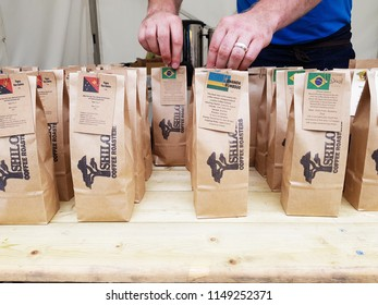 HUDDERSFIELD, UK - AUGUST 1, 2018: Coffee packaging at the Huddersfield Food and Drink Festival in the centre of Huddersfield, West Yorkshire, UK