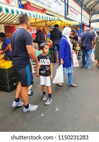 HUDDERSFIELD, UK - AUGUST 1, 2018: Unknown people shopping in Huddersfield Indoor Market in the centre of Huddersfield, West Yorkshire, UK